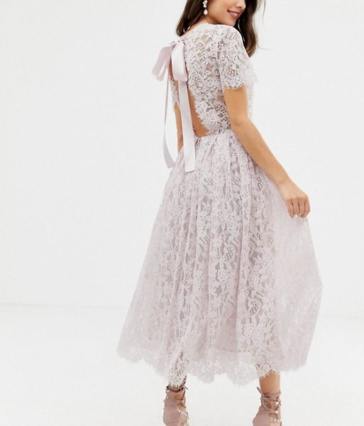895cc0f7853 ASOS DESIGN lace midi dress with ribbon tie and open back Light pink blush.  ASOS DESIGN lace midi dress with ribbon tie and open back Light pink blush