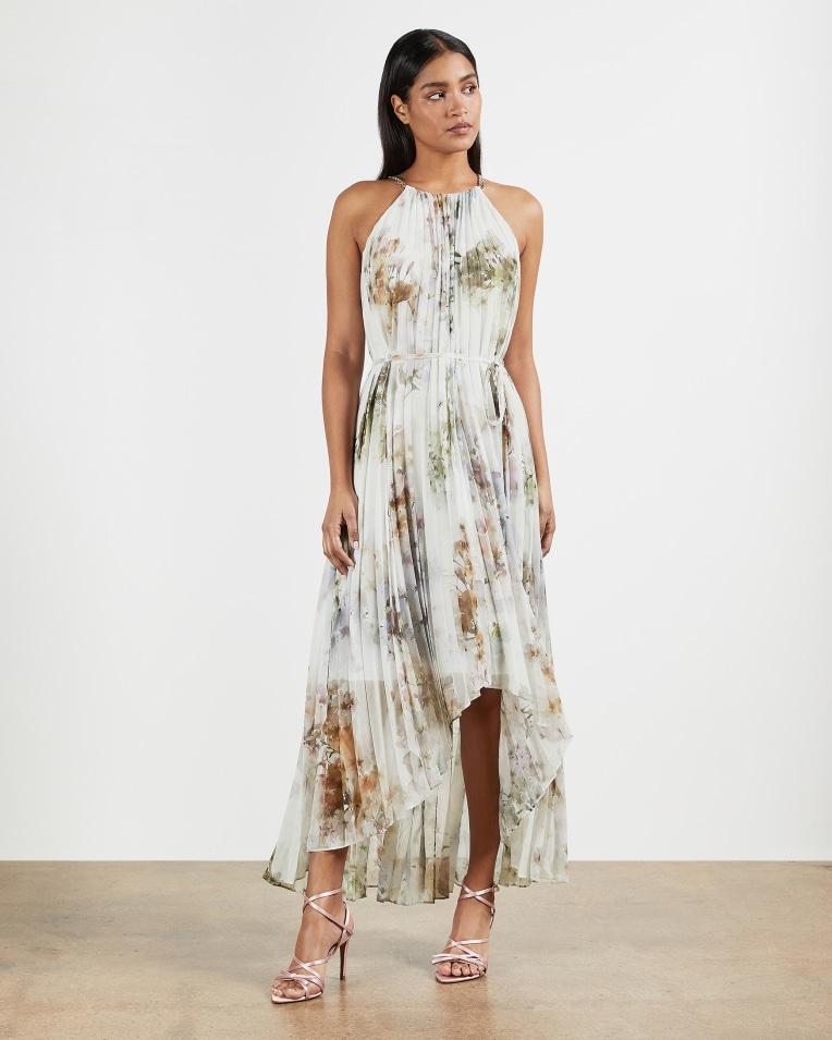 Vanilla dip hem pleated dress